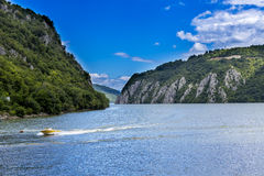 Spectacular view of Danube river flowing through rocky mountains. Under the blue sky stock image