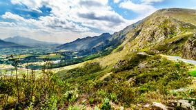 Spectacular view of Franschhoek Pass which runs along Middagskransberg between Franschhoek and Villiersdorp in the Western Cape. Spectacular view of Franschhoek stock images