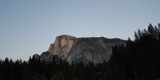 Yosemite Valley in all its glory - Half Dome Early Evening. Spectacular view of Half Dome mountain granite formation at Yosemite Valley in Yosemite National Park stock image