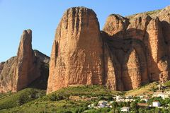 Spectacular view of Los Mallos de Riglos village. Riglos village with the cliffs Los Mallos is a paradise for climbing y the Spanish area of the Pyrenees Stock Photos