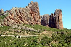 Spectacular view of Los Mallos de Riglos village. Riglos village with the cliffs Los Mallos is a paradise for climbing y the Spanish area of the Pyrenees Royalty Free Stock Photo