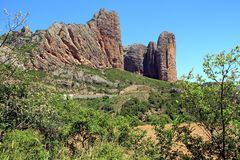 Spectacular view of Los Mallos de Riglos village. Riglos village with the cliffs Los Mallos is a paradise for climbing y the Spanish area of the Pyrenees Stock Images