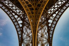 Spectacular view on the metal arcs of the Eiffel tower. Eiffel tower, Paris from below, showing the spectaculair arc perfectly centrated Stock Photography