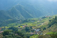 Spectacular view on mountain valley village with rice terraces. Vietnam Stock Images