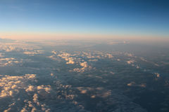 Spectacular view of a sunset above the clouds from airplane wind Royalty Free Stock Photography