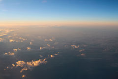 Spectacular view of a sunset above the clouds from airplane wind Stock Photo