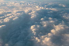 Spectacular view of a sunset above the clouds from airplane wind Royalty Free Stock Image