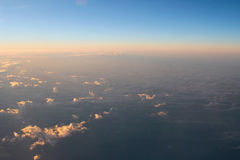 Spectacular view of a sunset above the clouds from airplane wind Stock Photography