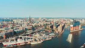 Spectacular view from the top to the urban landscape Hamburg City and Port of Hamburg on a sunny day with a clear stock footage