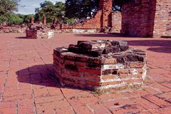 The left over pillar within Wat Mahathat. A spectacular view from Wat Mahathat with stones, pillars, walls and pavement which is ruined by aggressor in the past Royalty Free Stock Photos
