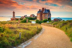 Spectacular walkway and lighthouse in Brittany region, Ploumanach, France, Europe Royalty Free Stock Photo