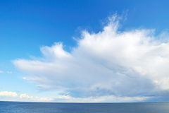 Spectacular white cloud over the sea. Image of a spectacular white cloud over the sea ant the blue sky stock image