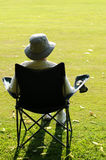 The spectator. Portrait from behind of spectator in deckchair Royalty Free Stock Image