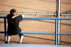 Spectator of baseball. Spectator waiting for the inning to start stock image