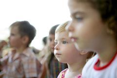 Spectator children looking at the show Stock Photos