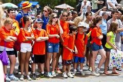Spectator in orange T-shirt watch Royalty Free Stock Image
