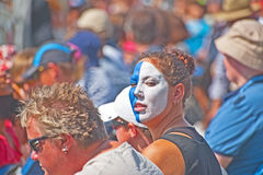 Spectator painted in Scottish colors. A woman with her face painted blue and white, the colors of the Scottish flag, attending the Inverness Highland Games on Royalty Free Stock Photo
