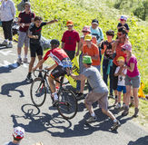 Spectator Pushing a Cyclist - Tour de France 2016. Col du Grand Colombier,France - July 17, 2016: Unidentified spectator is pushing the cyclist Adam Hansen of Royalty Free Stock Image