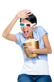 Spectator watching 3D film with bowl of popcorn Royalty Free Stock Photography