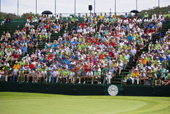 Spectators on the 18th - Day Two. Crowds pack the grandstands on the 18th to view the presentation of the trophy to the winner of the Seniors challenge Royalty Free Stock Images
