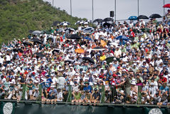 Spectators on the 18th. Crowds pack the grandstands on the 18th Stock Photos