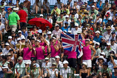 Spectators Pack the Pavilion - 18th Green. Crowds pack the grandstands on the 18th Royalty Free Stock Photo