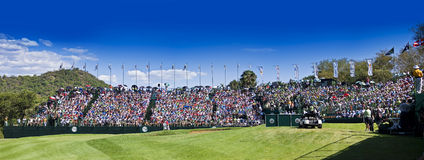Spectators on the 18th. Crowds pack the grandstands on the 18th. Panoramic Stock Photo