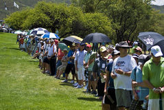 Spectators on the 1st fairway. Hordes of spectators line the barrier on the 1st fairway Stock Photos