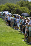 Spectators on the 1st fairway. Hordes of spectators line the barrier on the 1st fairway Royalty Free Stock Photo
