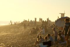 Spectators on the beach during sunset at The Wedge royalty free stock photo