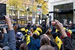 Spectators with Camera Phones Recording Occupy Portland Protest. PORTLAND, OREGON - NOV 17: Spectactors taking pictures with camera phones of Police in Riot Gear Royalty Free Stock Images