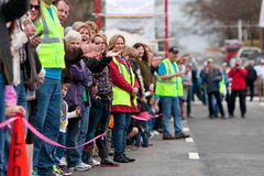 Spectators Cheer Oncoming Participants In Small Town Race Stock Photo