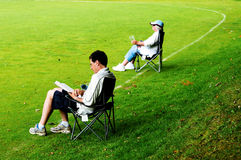 Spectators in deckchairs Royalty Free Stock Photography