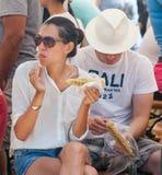 Spectators Festival Rozhen 2015 eat corn Stock Images