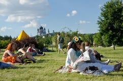 Spectators of the folk festival Stock Photos