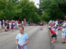 Spectators at Fourth of July parade. Winnetka, Illinois, United States - July 4, 2007: Spectators wait for a Fourth of July parade to begin Stock Image