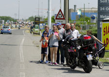 Spectators during Giro d'Italia 2014. Bellusco, Italy, Sunday, May 25, 2014:spectators waiting convoy riders participating on the the Giro d'Italia 2014 royalty free stock photo