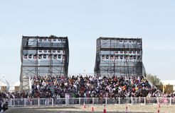 Spectators on grandstand to watch horse show Royalty Free Stock Image
