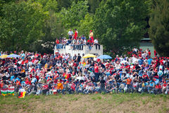 Spectators on grass on The Formula 1 Grand Prix Royalty Free Stock Photo