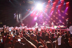 Spectators hold American flags on DAUGHTRY group performs stock photos