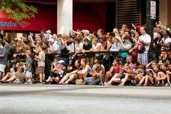 Spectators Line Street In Atlanta To Watch Dragon Con Parade. Atlanta, GA, USA - August 31, 2013:  A large crowd of spectators lines Peachtree Street in downtown Royalty Free Stock Photo