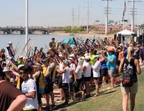 Spectators Make a Tunnel at Dragon Boat Festival. TEMPE, AZ/USA - MARCH 28: Unnamed people gather at the Dragon Boat Festival on Tempe Town Lake, Tempe, Arizona royalty free stock images