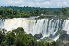 Spectators on observation deck watching Iguazu Falls Royalty Free Stock Images