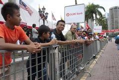 Spectators OCBC Cycle Malaysia 2011. KUALA LUMPUR, MALAYSIA - October 16: Cycling spectators lining in the race route during OCBC Cycle Malaysia in Kuala Lumpur Stock Image