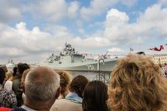 Spectators at the parade of warships. royalty free stock photo