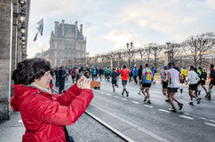 Spectators and participants of the annual Paris Marathon on the Royalty Free Stock Image