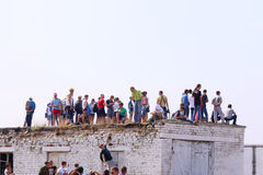 Spectators on roof on airshow Stock Photography