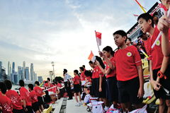 Spectators singing the Singapore national anthem during National Day Parade (NDP) Rehearsal 2013 Royalty Free Stock Photos