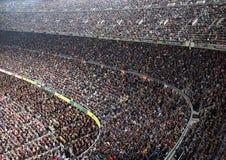 Spectators in the stadium watching sports Stock Photo