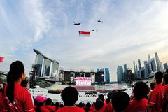 Spectators standing at attention as the national flag flypast during National Day Parade (NDP) Rehearsal 2013 Stock Image